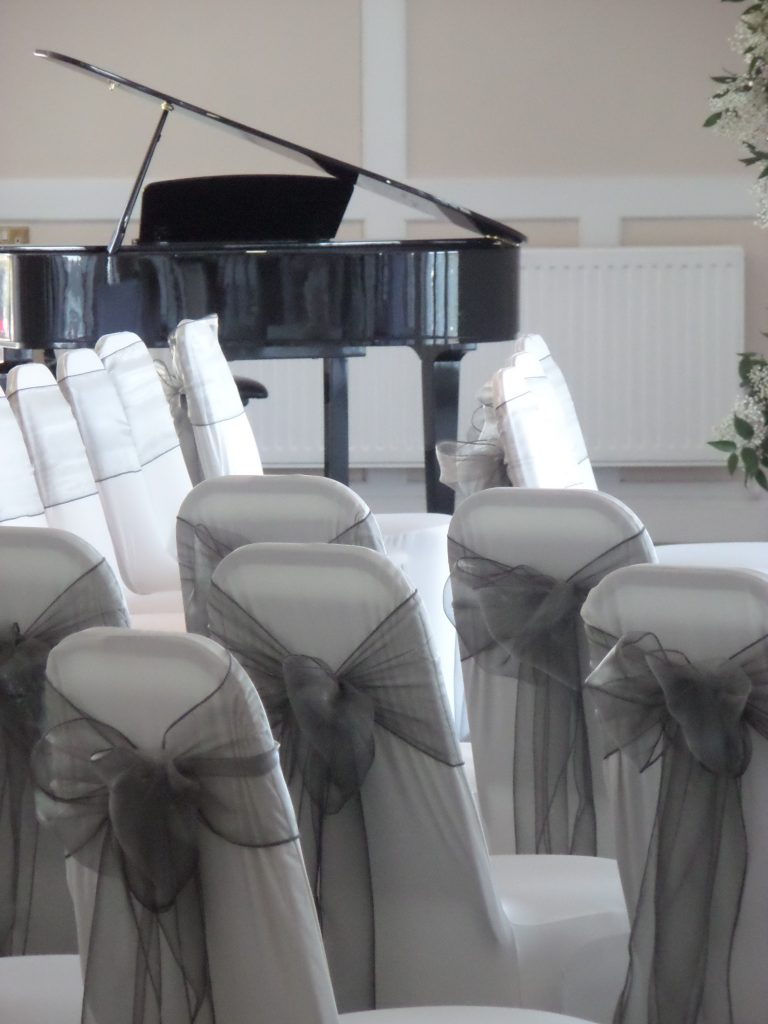 Wedding Ceremony Chairs with Baby Grand Piano Shell